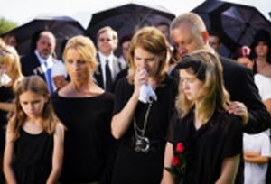 stock-photo-20413842-family-at-a-funeral-2