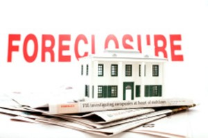 stock-photo-7329180-economic-anxiety-foreclosure-home-for-sale-newspaper-recession-2
